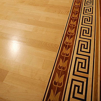 See how the addition of a Heritage Marquetry border adds style to your floor.